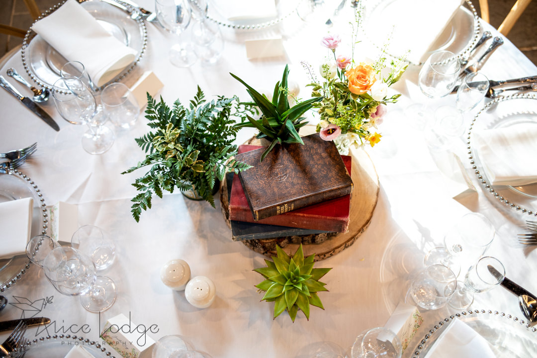 National centre for early music wedding table centre piece with books, wood and flowers