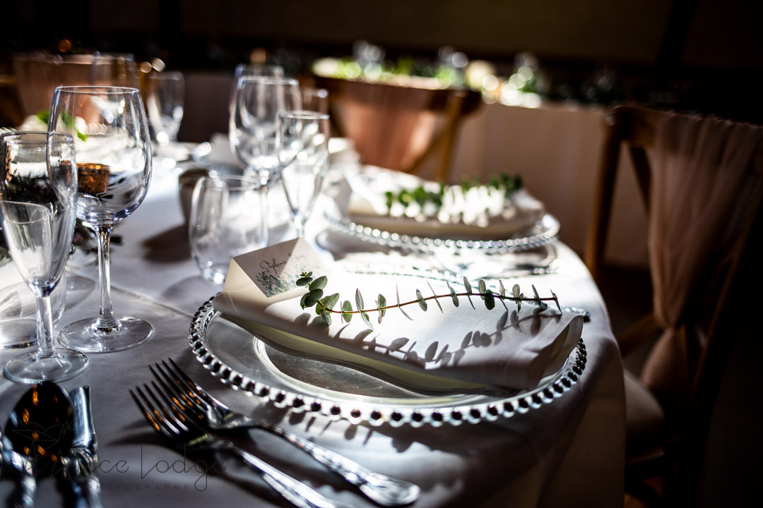 national centre for early music york wedding table dinner set with plate with silver rim white napkins and foliage