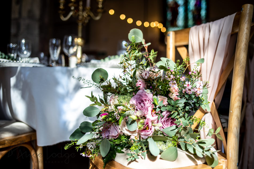 national centre for early music york wedding bouquet lying on chair in green and pink