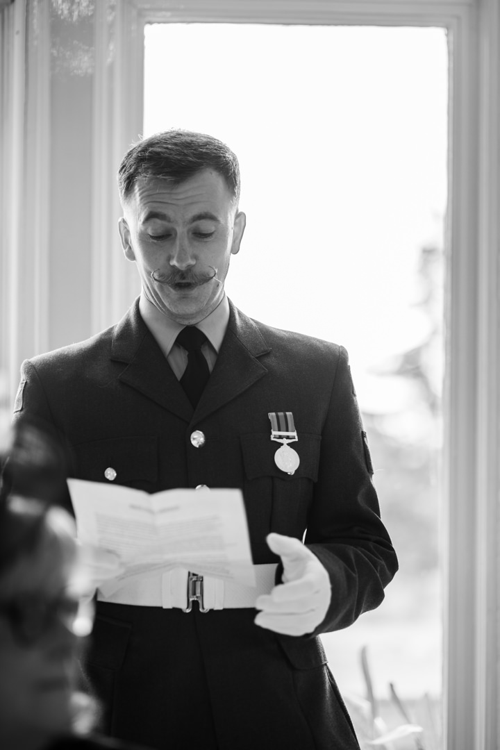 Brother of groom giving wedding speech wearing RAF suit