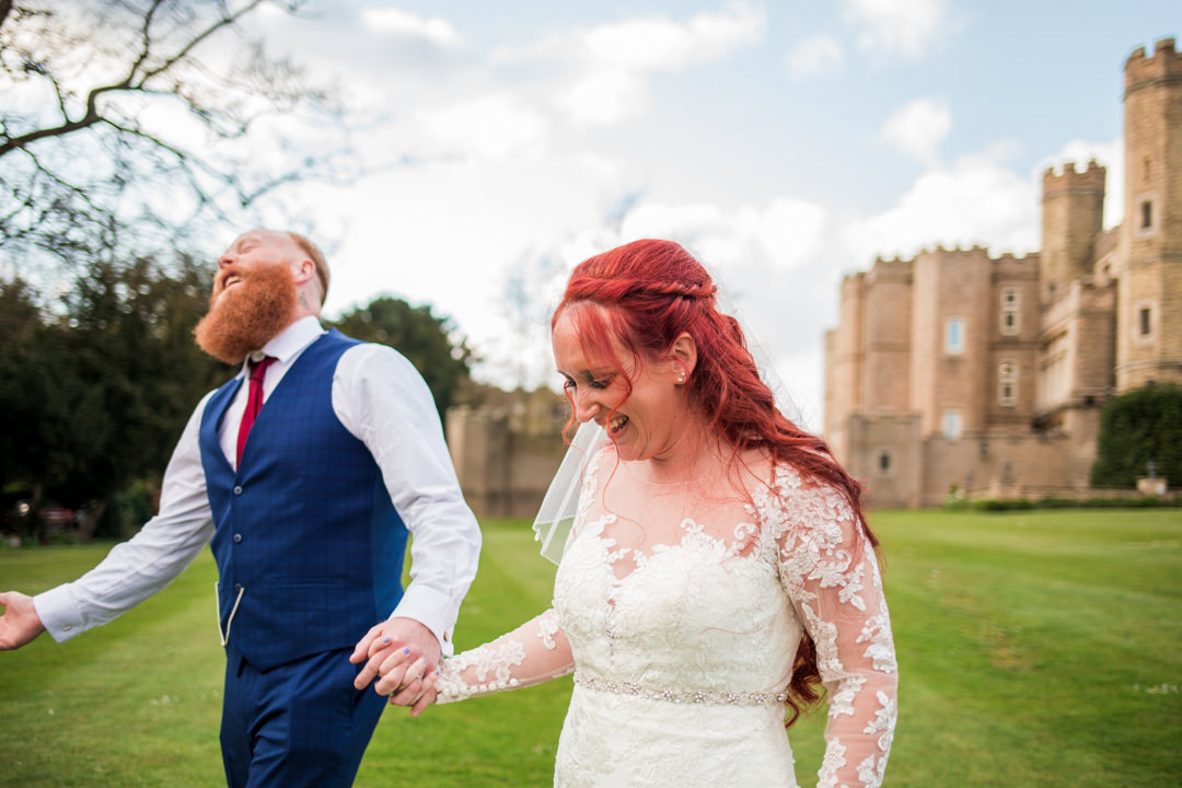 Red haired bride and groom walking and smiling