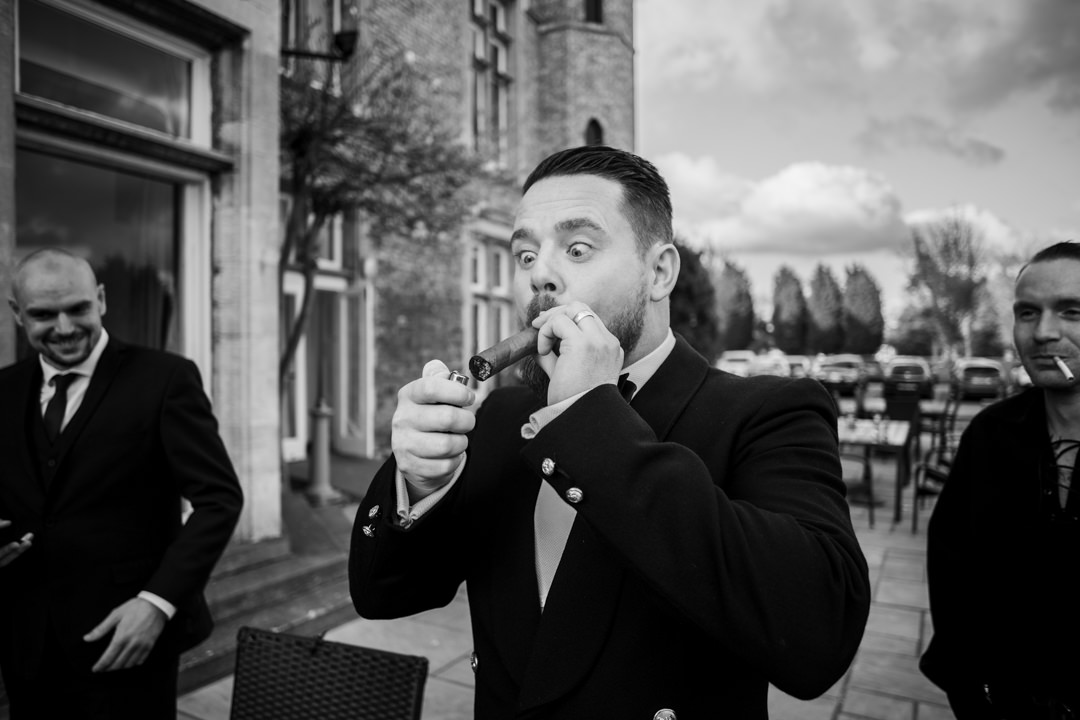 Wedding guest with big cigar