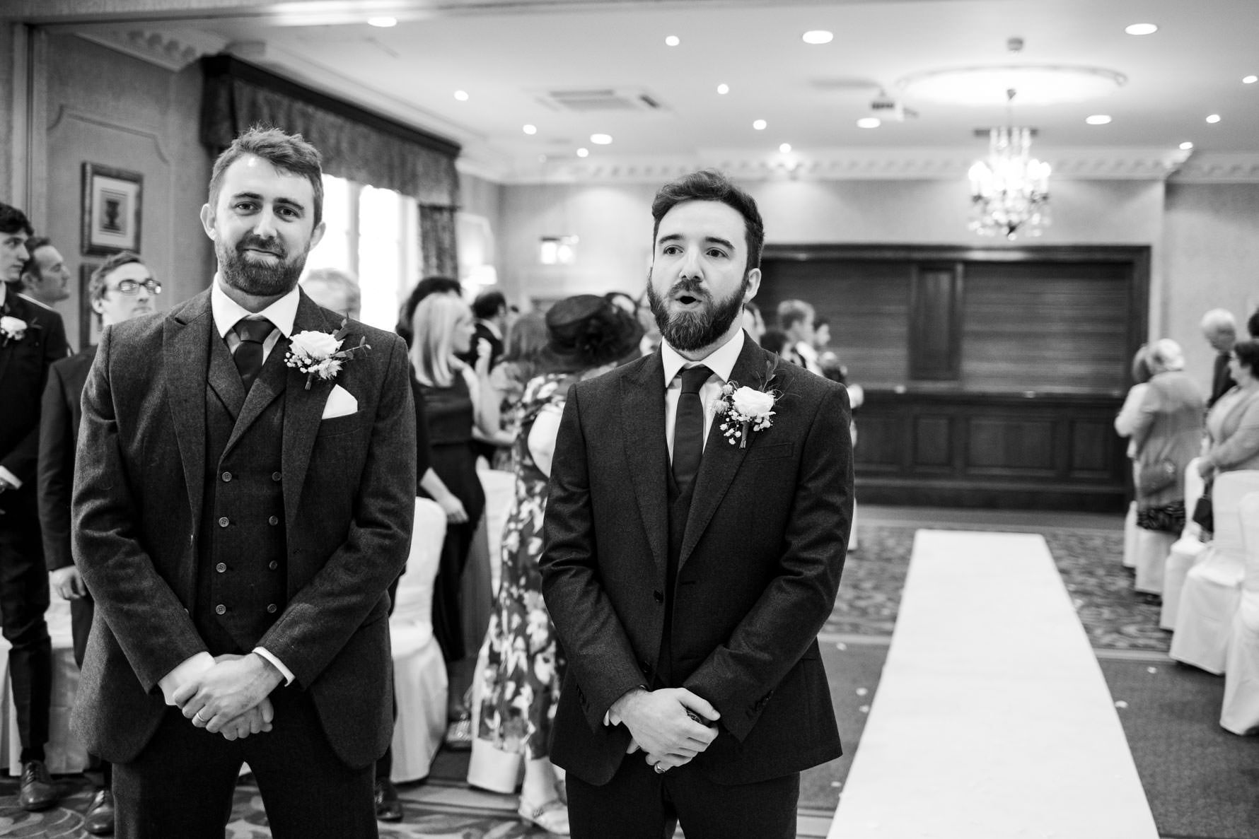 groom and best man waiting for bride in ceremony room
