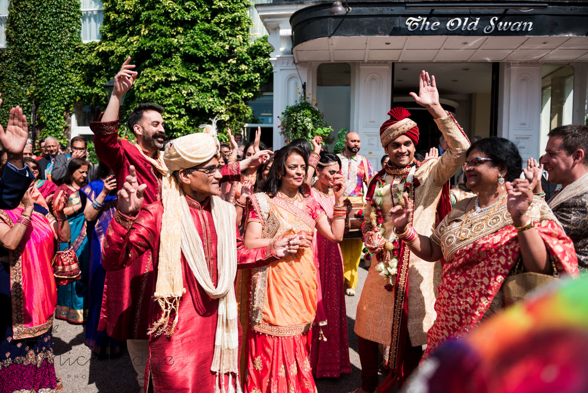 Indian wedding guests dancing in sunshine outside old swan hotel harrogate