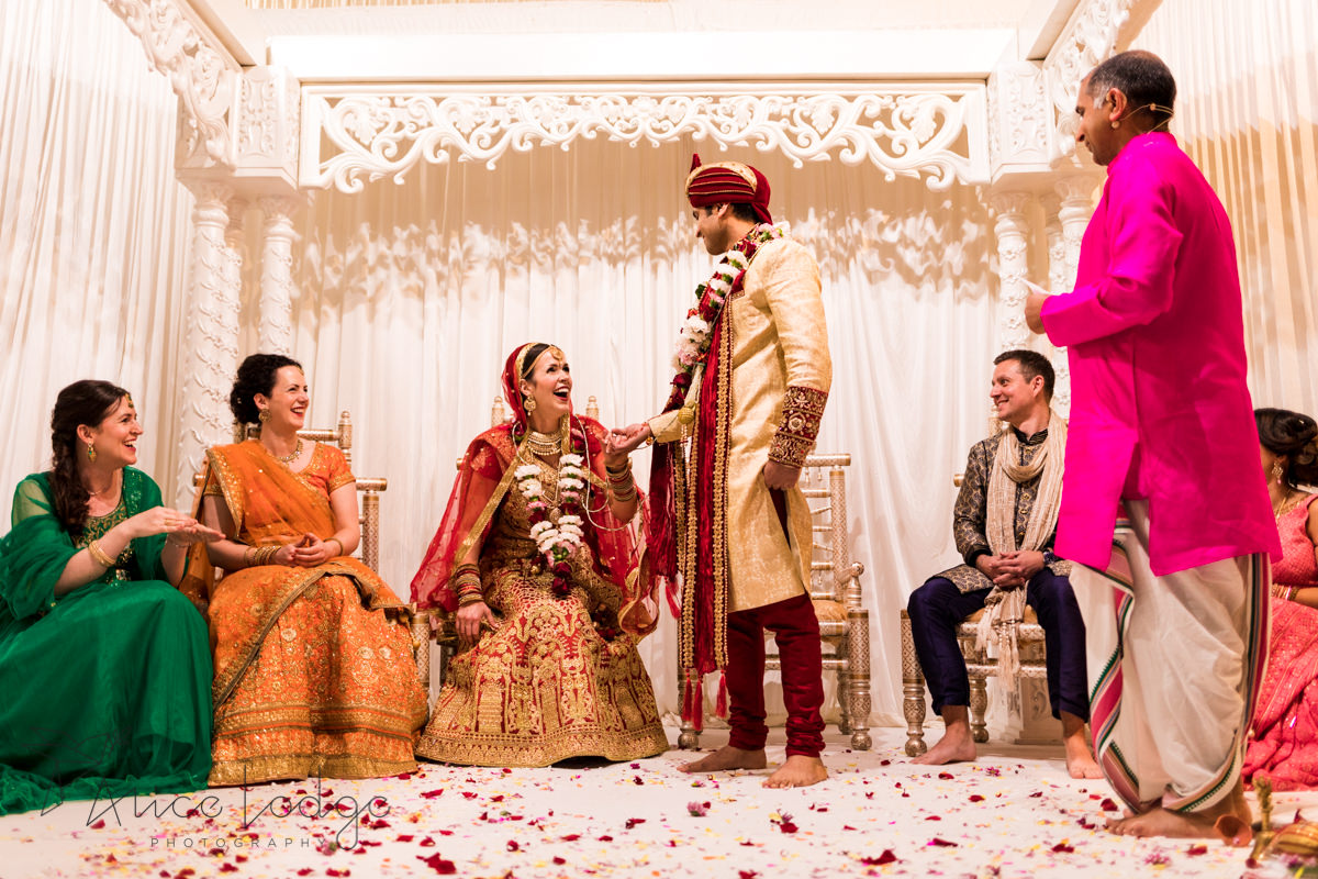 Bride laughing at Hindu wedding ceremony