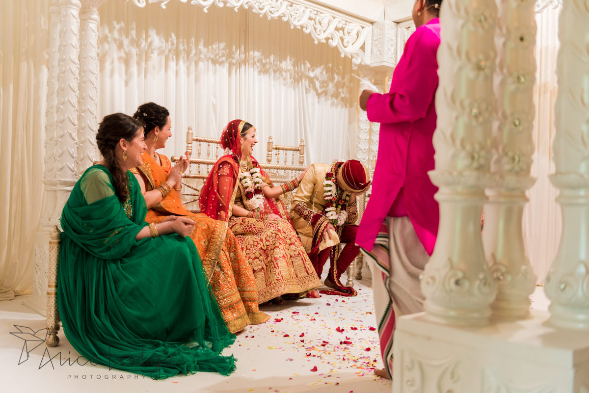 Groom laughing on Mandap at Hindu wedding ceremony