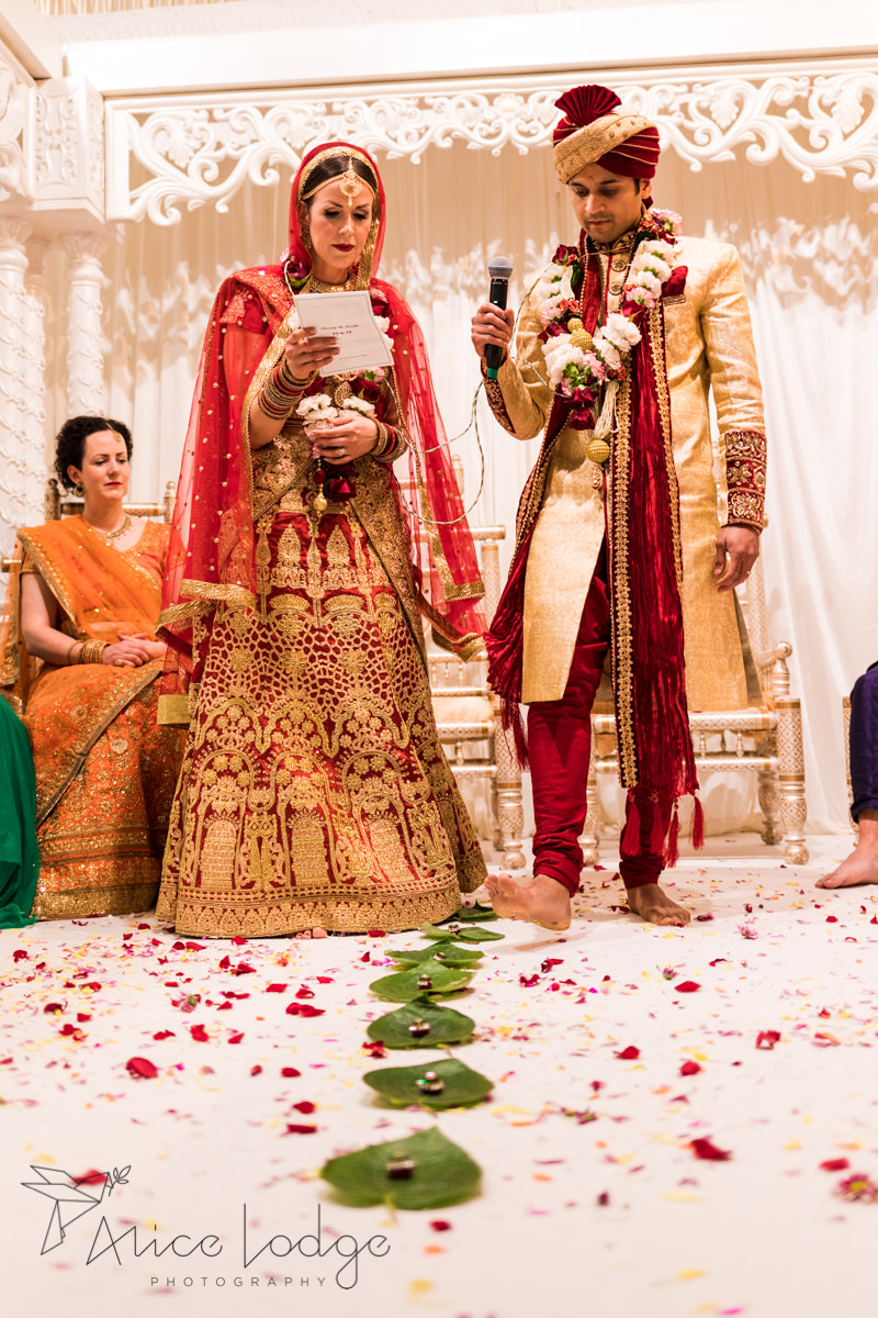 Indian bride and groom taking the seven steps together