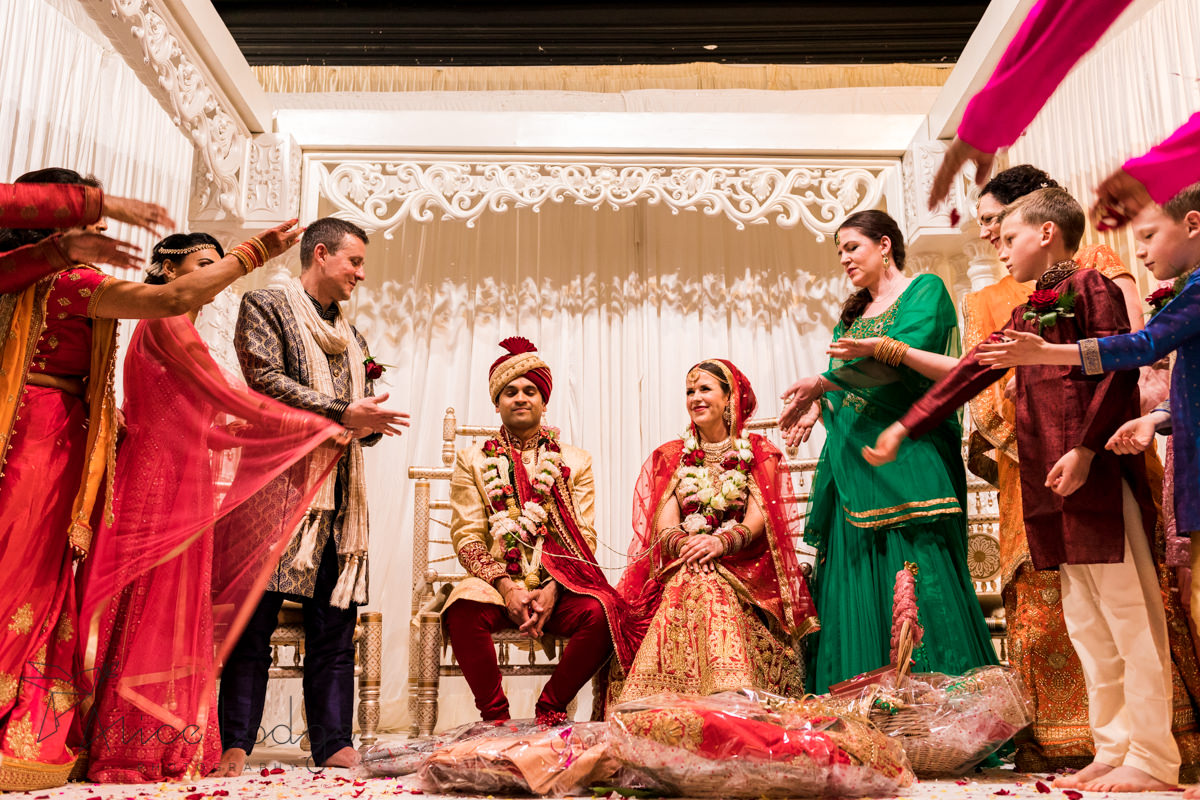 Rise being thrown of wedding couple during Hindu wedding