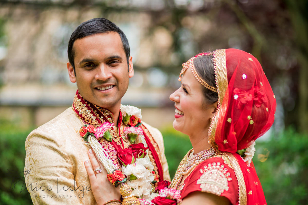 Bride looking at Indian groom smiling
