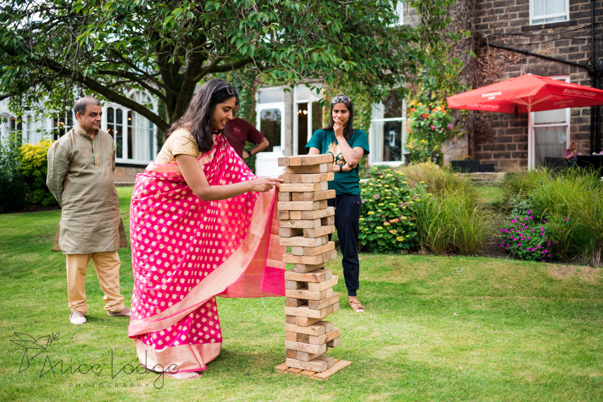 Wedding guests playing giant jenga outside old swan hotel