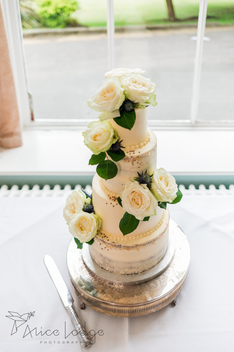 Wedding cake in white with white roses