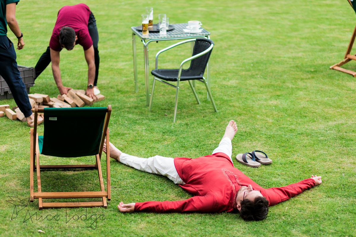 Wedding guest sleeping on lawn