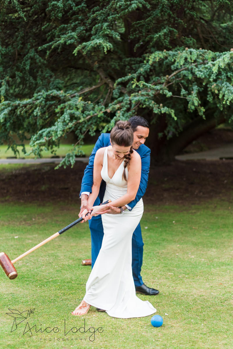 Bride and groom playing lawn game together