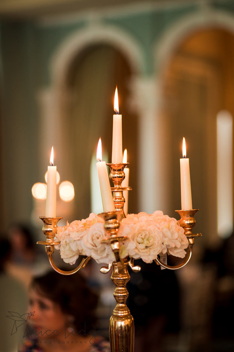 Gold candelabra with white flowers
