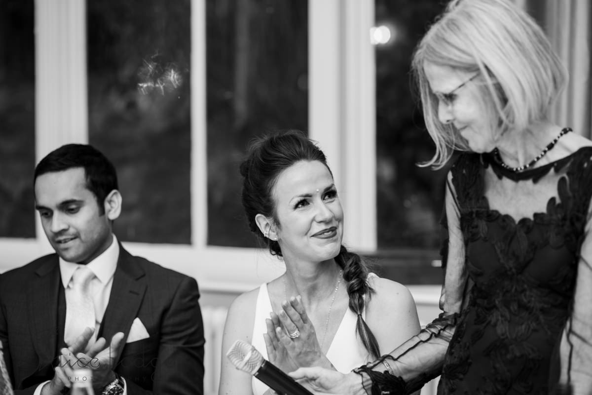 Bride looking lovingly at mother after wedding speech