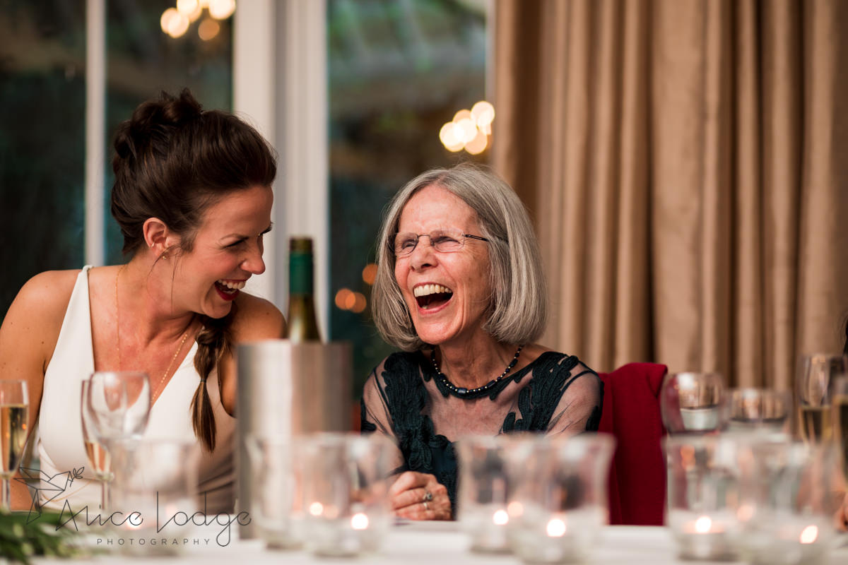 Mother of the bride laughing at wedding speech