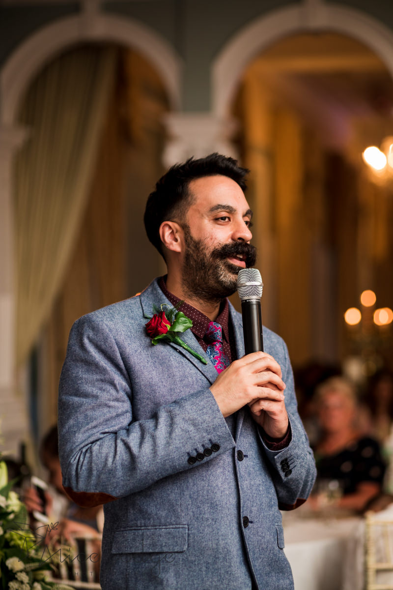 Best man giving speech during wedding reception
