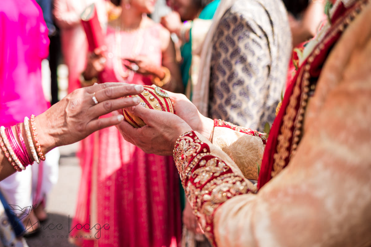 Indian wedding egg in grooms hand