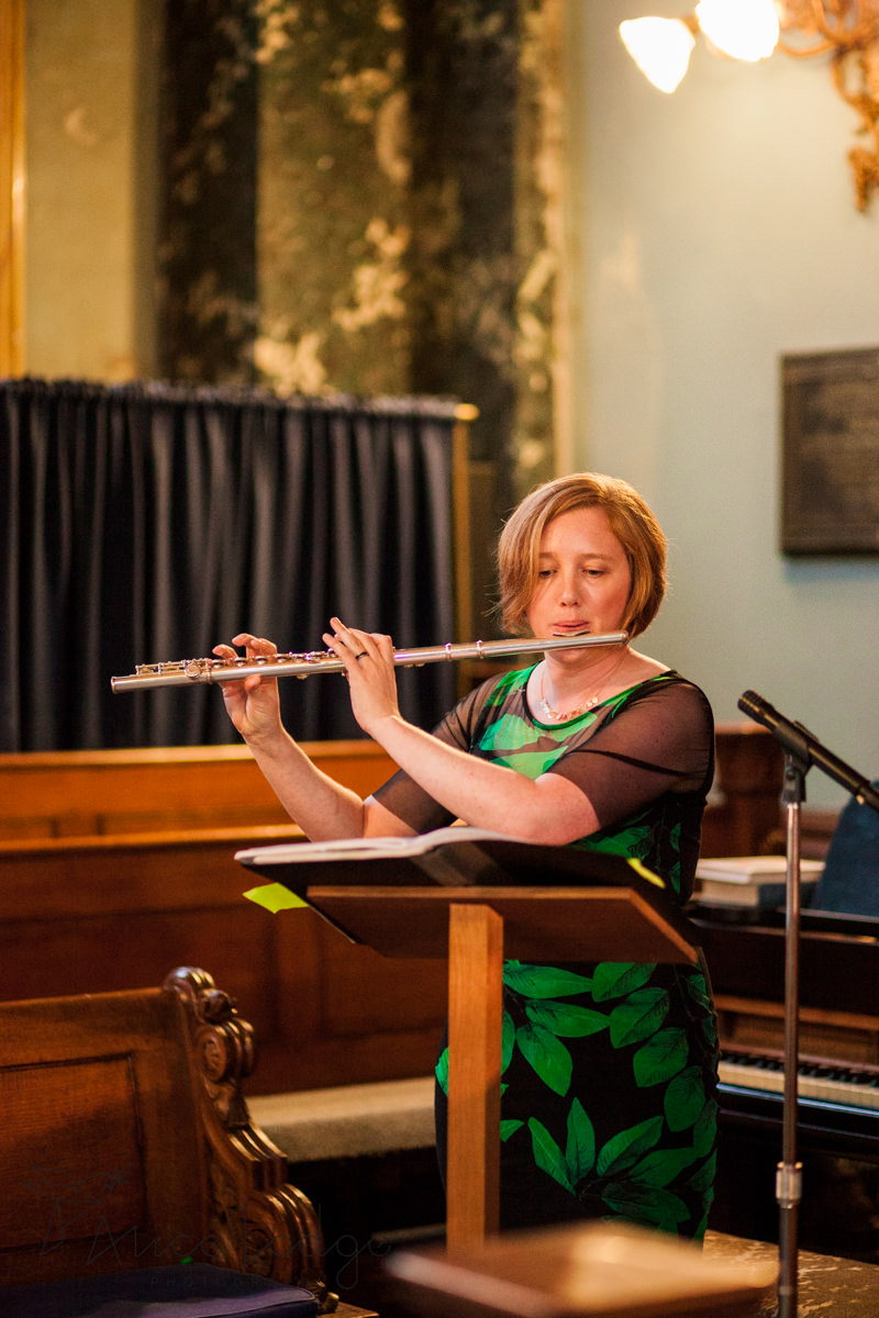 female flute player in church