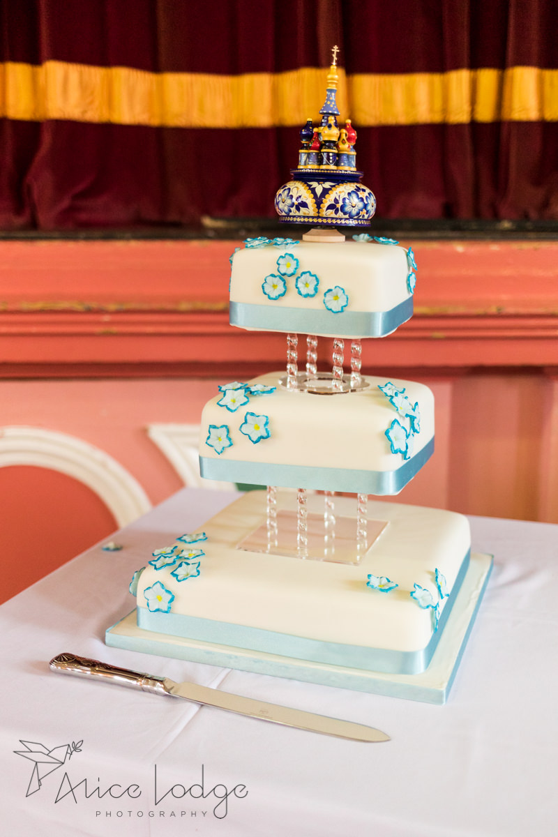 Wedding cake with blue icing flowers