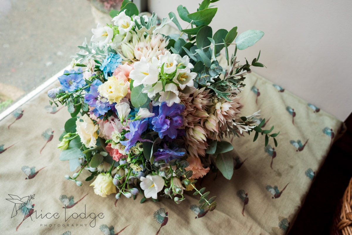 Wedding bouquet with pink, blue and white flowers