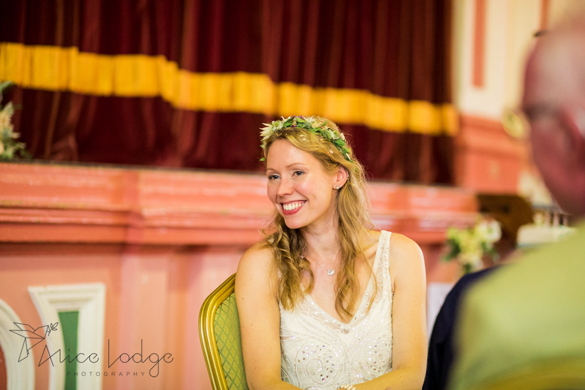bride smiling during wedding speech
