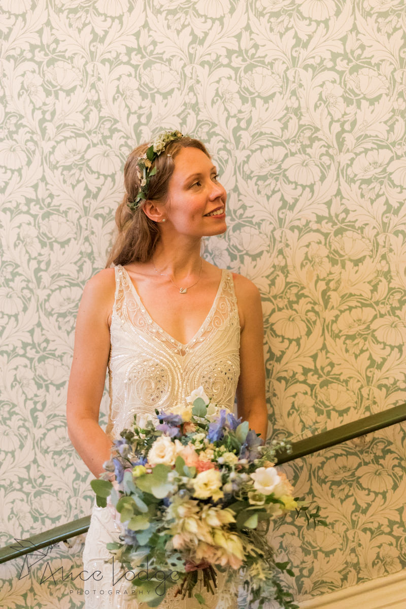 bride in front of vintage wallpaper at Victoria Hall