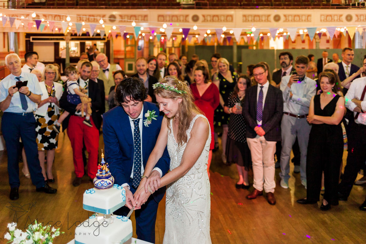 cake cutting at wedding at Victoria Hall Saltaire