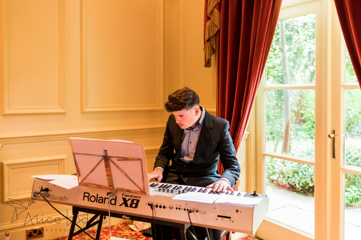 wedding guest playing piano