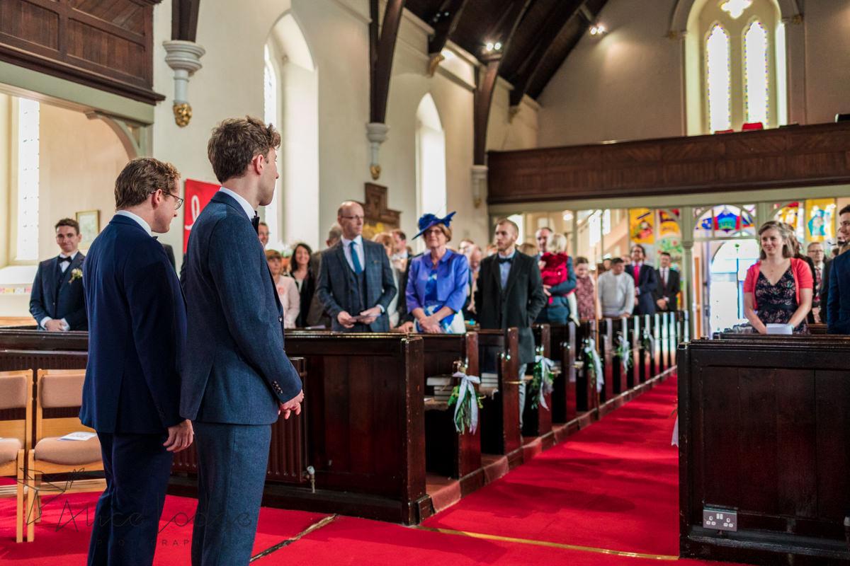 groom looking down the aisle