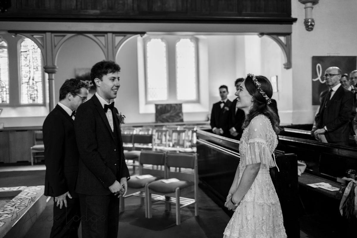 groom seeing bride in church