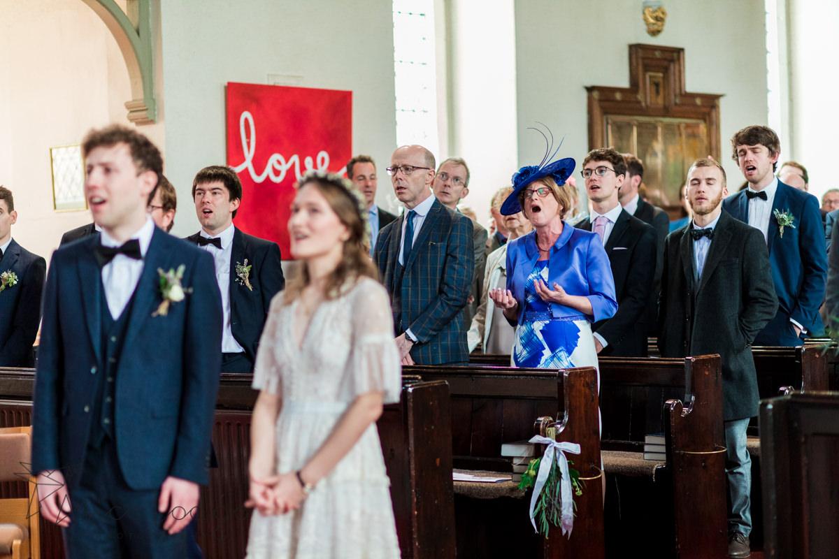wedding guest singing in st. Thomas's church