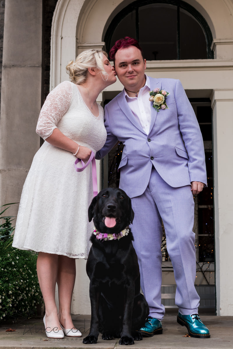 wedding couple with black dog