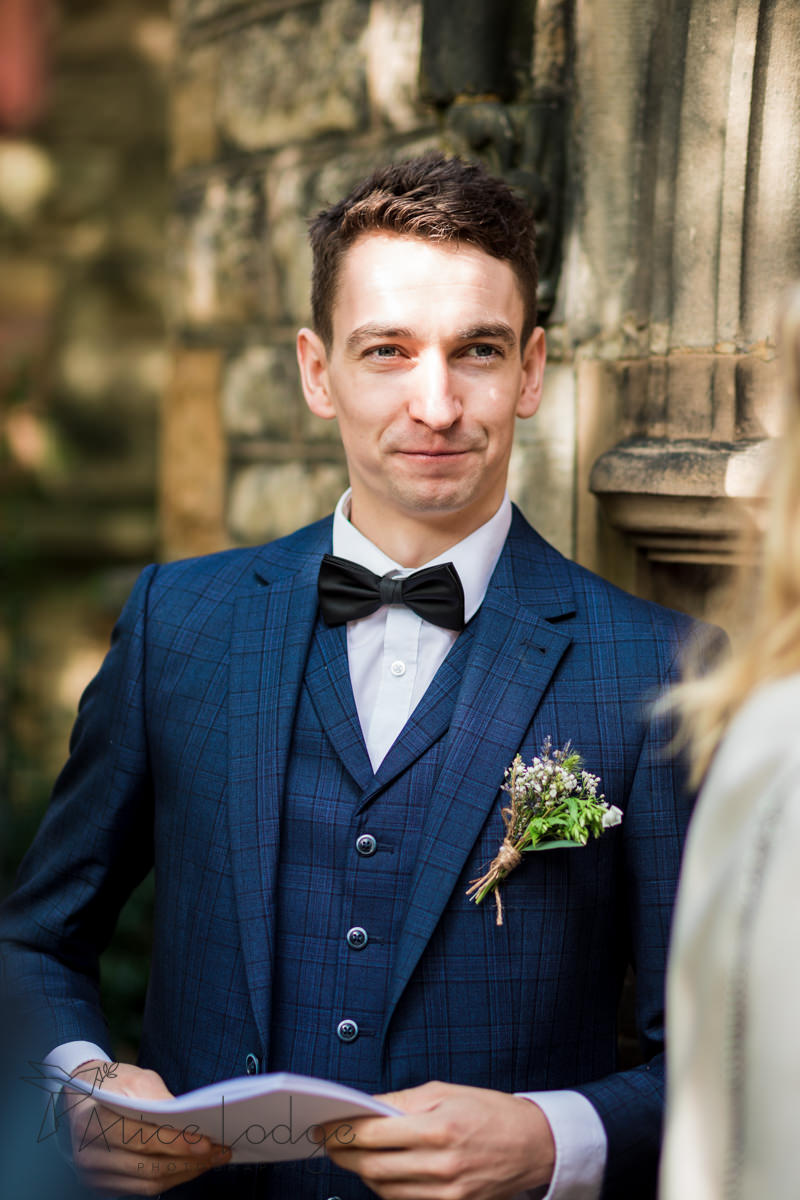 groomsman in blue suit