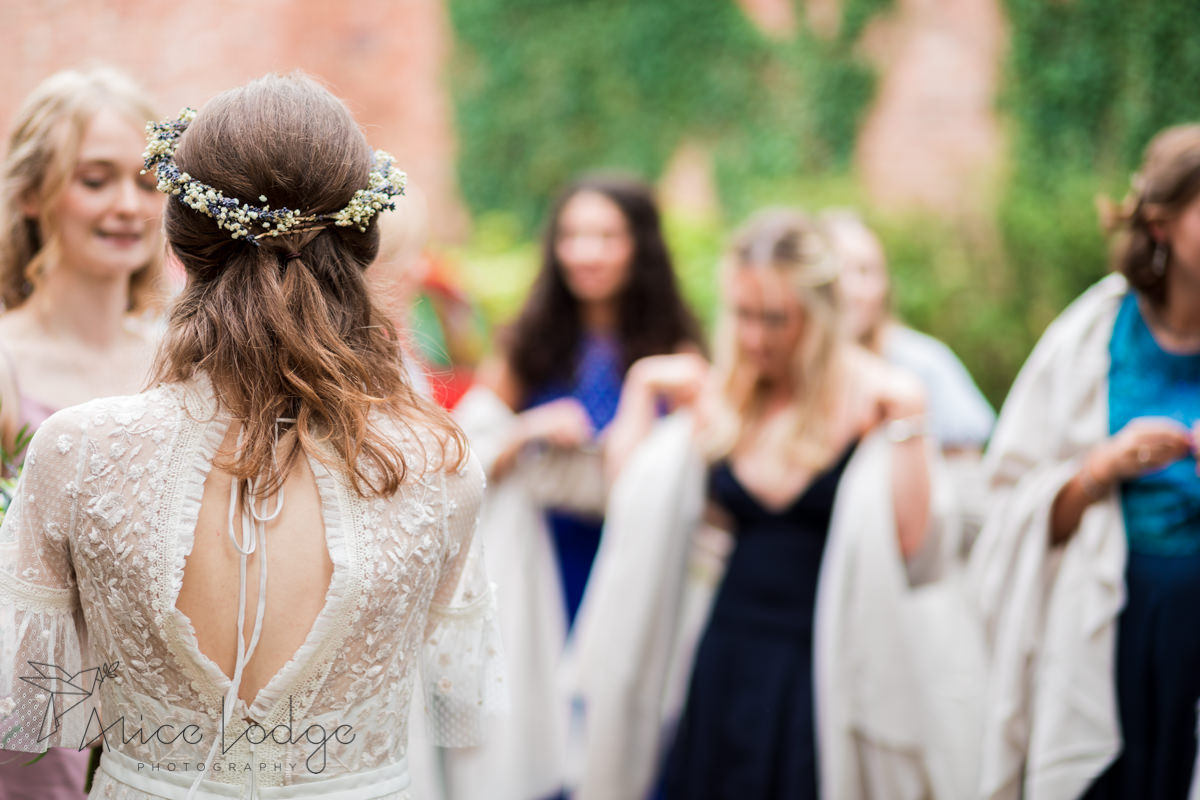 back of bride with flower crown
