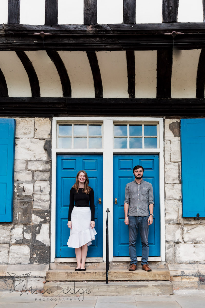 Man and woman standing in front of blue door in York