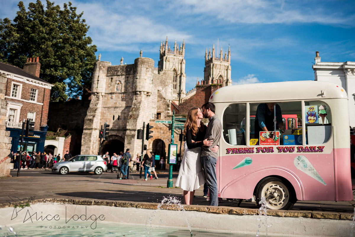 Couple kissing in museums square York in front of ice cream van