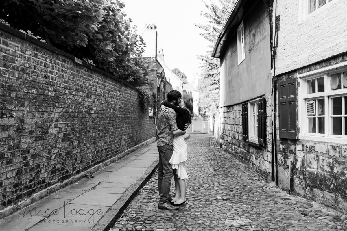 Man and woman hugging in back streets of York Minster