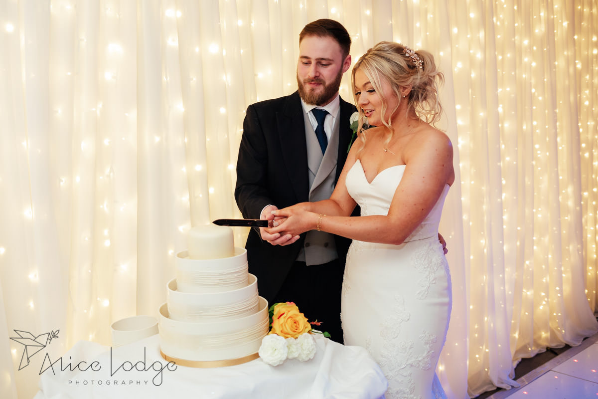cutting of the wedding cake at whitley hall hotel