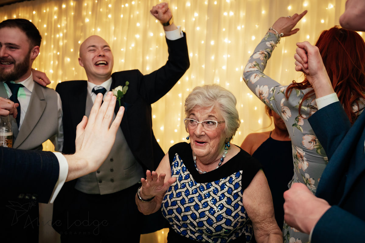 wedding guests dancing with grandmother