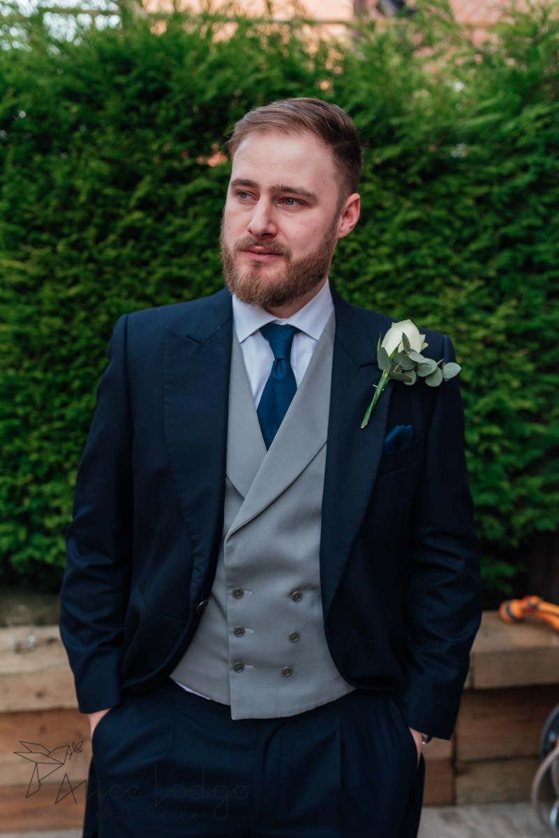 groom with blue suit