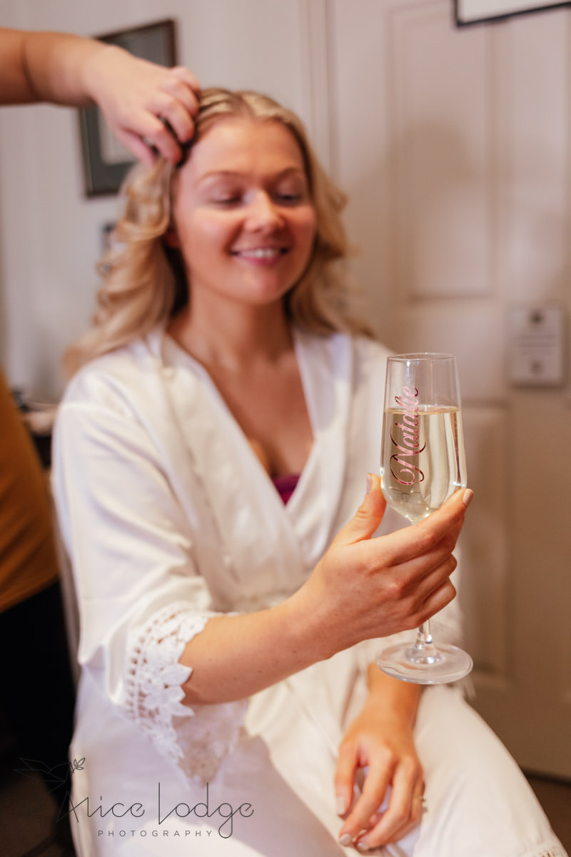 blond bride holding fizz glass