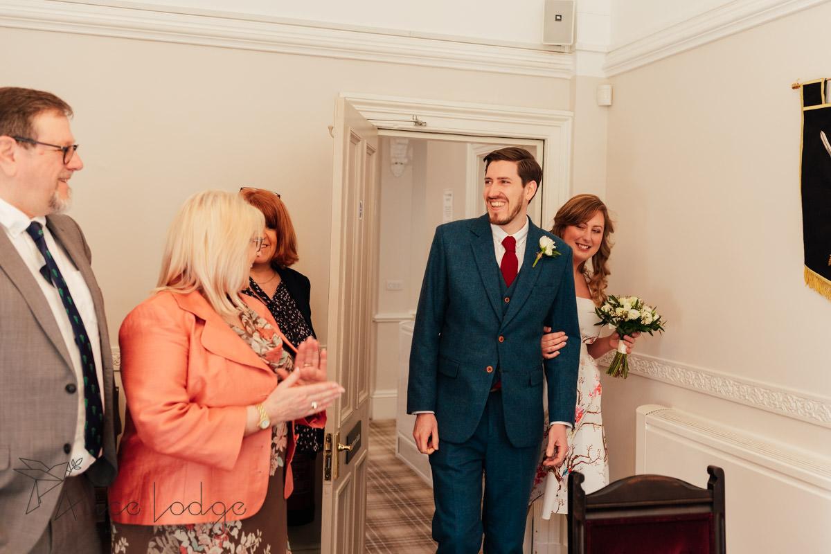 bride and groom entering at york registry office