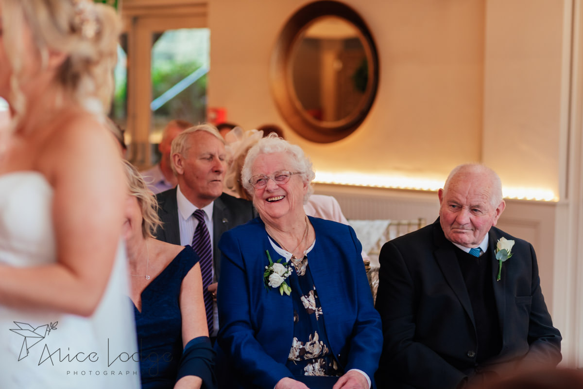 grandmother smiling at wedding ceremony