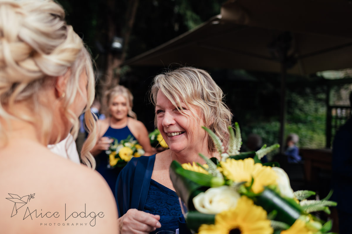 female wedding guest with blond hair