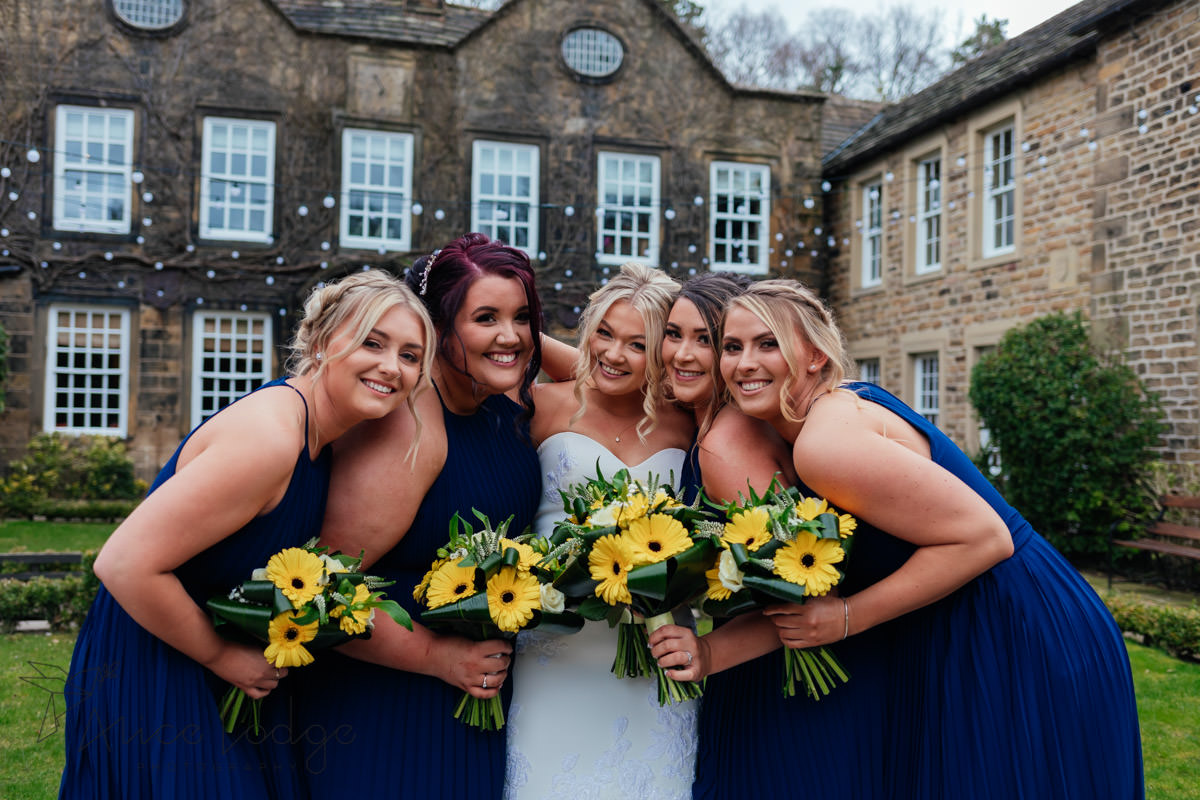 bridesmaid with blue dresses and yellow flowers at whitley hall hotel