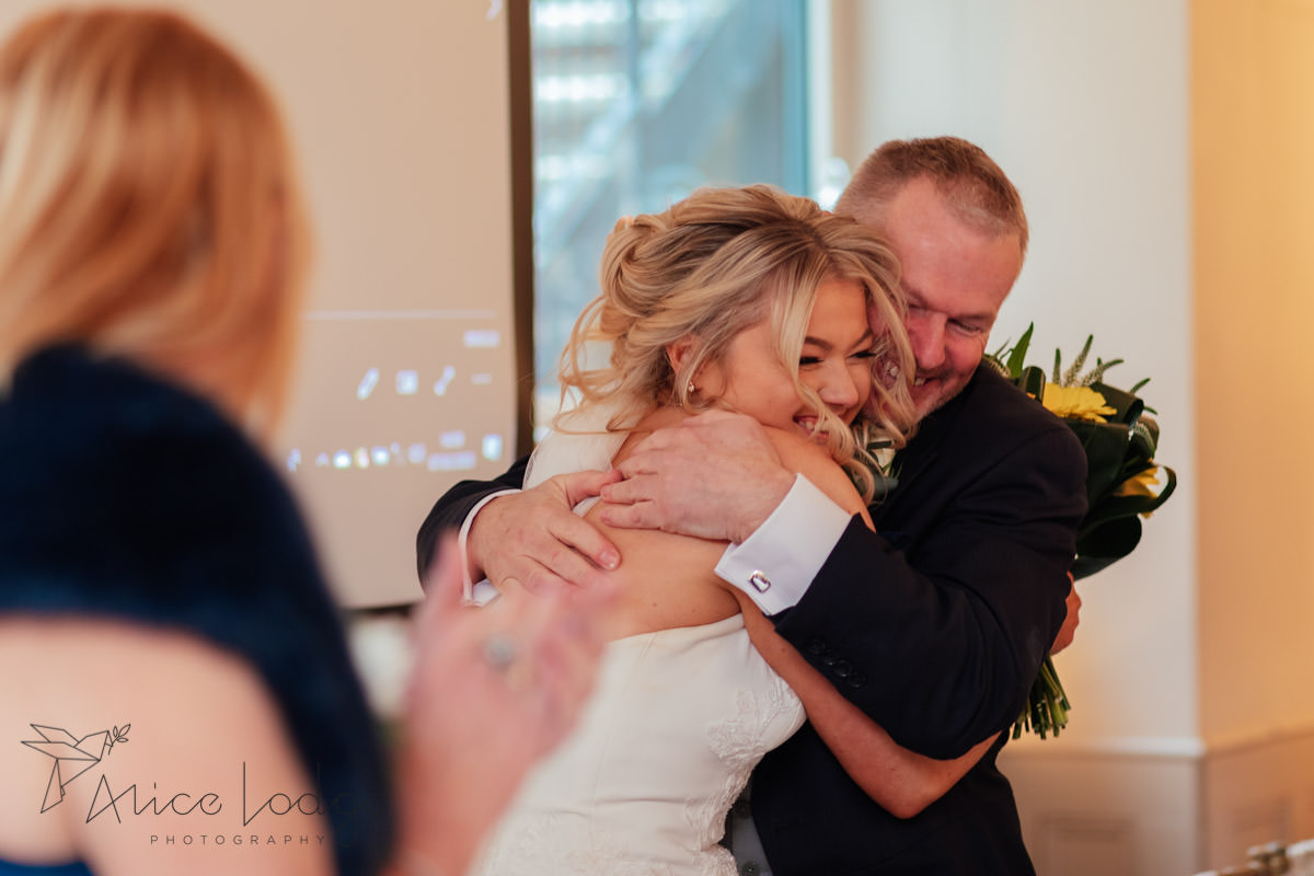 bride hugging father after speech