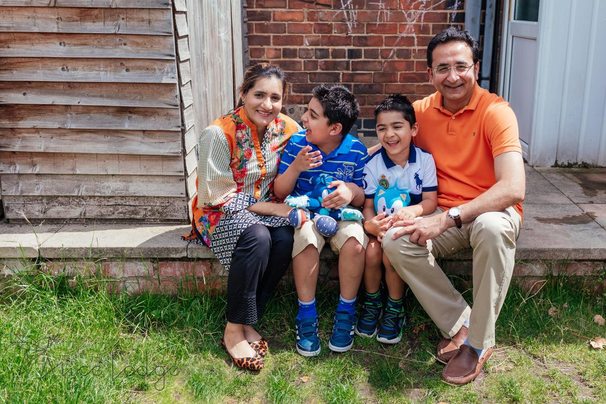 family sitting in yard