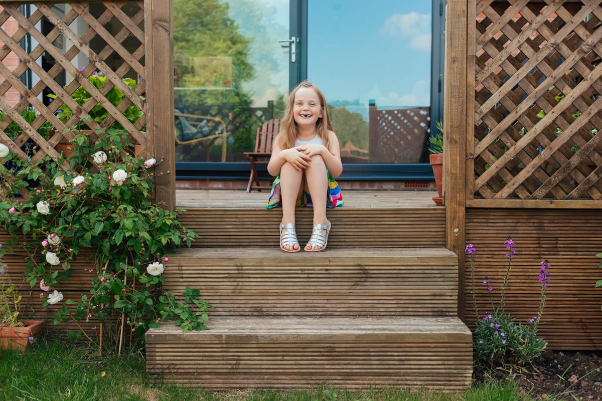 girl sitting on step