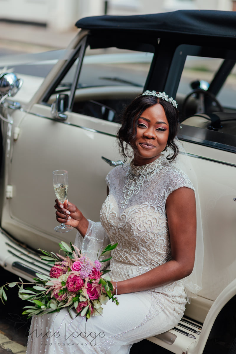 bride with wedding car